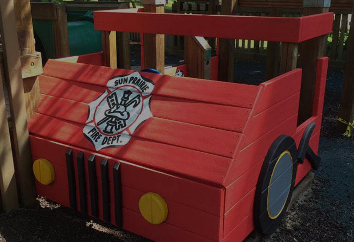 Fire engine playground equipment at Sun Prairie Dream Park